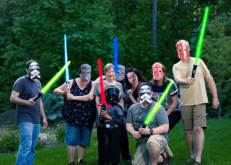 Family photo with lightsabers in Newberg Oregon by Pelletier Photos